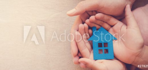 hands holding paper house, family home, homeless shelter, international day of families, foster home care, family day care, social distancing, stay at home, housing mortgage crisis concept